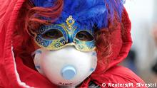 BdTD Italien | Karnevalist mit einer Gesichtsmaske beim Karneval in Venedig