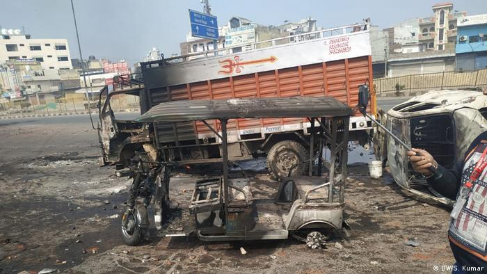 Burned out vehicle in Delhi following the riots