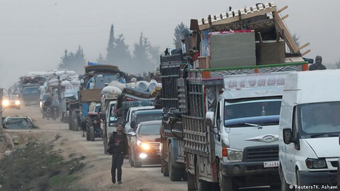 A view of trucks carrying belongings of displaced Syrians