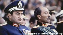 FILE - In this Oct. 6, 1981 file photo, Egyptian President Anwar Sadat, right, and Vice President Hosni Mubarak sit on the reviewing stand during a military parade just before soldiers opened fire from a truck during the parade at the reviewing stand, killing Sadat and injuring Mubarak. Egypt's state TV said Tuesday, Feb. 25, 2020, that the country's former President Hosni Mubarak, ousted in the 2011 Arab Spring uprising, has died at 91. Mubarak, who was in power for almost three decades, was forced to resign on Feb. 11, 2011, after following 18 days of protests around the country. (AP Photo/Bill Foley, File) |