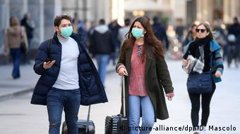 Italy —tourists with face masks in Milan because of the Coronavirus