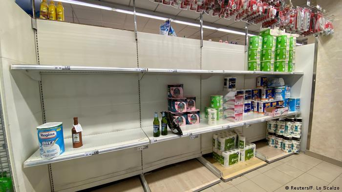Near-empty shelves in shop in Milan