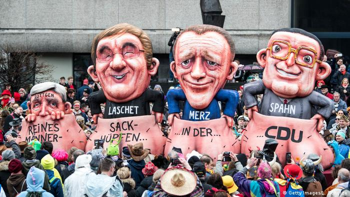 Norbert Röttgen, Armin Laschet, Friedrich Merz e Jens Spahn: corrida de saco de homens na CDU, diz alegoria do Carnaval de Düsseldorf