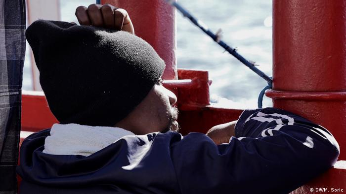 On board the Ocean Viking, a refugee looks out to sea. (DW/M. Soric)