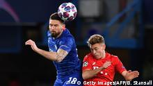 Chelsea's French striker Olivier Giroud (L) vies with Bayern Munich's German midfielder Joshua Kimmich (R) during the UEFA Champion's League round of 16 first leg football match between Chelsea and Bayern Munich at Stamford Bridge in London on February 25, 2020. (Photo by Ben STANSALL / AFP) (Photo by BEN STANSALL/AFP via Getty Images)