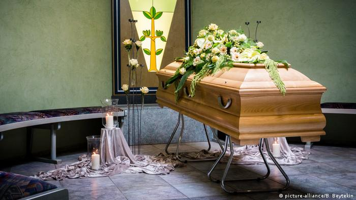 Coffin draped with flowers