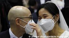 A couple wears masks in a mass wedding ceremony at the Cheong Shim Peace World Center in Gapyeong, South Korea, Friday, Feb. 7, 2020. South Korean and foreign couples exchanged or reaffirmed marriage vows in the Unification Church's mass wedding arranged by Hak Ja Han Moon, wife of the late Rev. Sun Myung Moon, the controversial founder of the church. (AP Photo/Ahn Young-joon) |