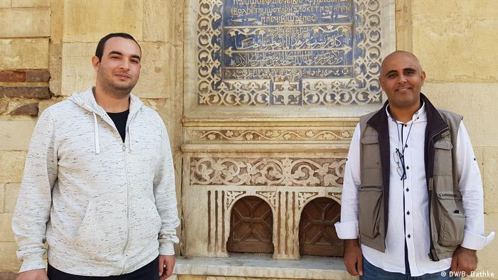 A picture of ToBadaa founder Ahmed Hamed and freelance tour guide Nader Khattab in Cairo's Coptic quarter.