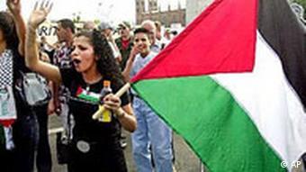 Palestinian women wave a flag in Berlin