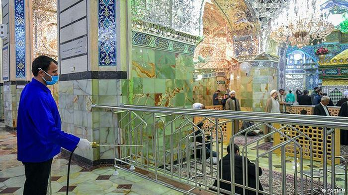 Iran and the coronavirus: A worker disinfects the holy shrine of Qom