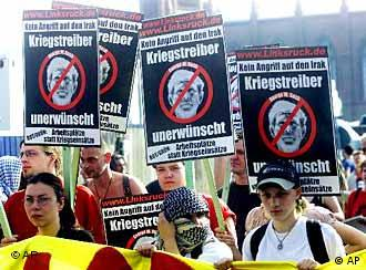 Demonstrators in Berlin in May carry signs reading: War monger not welcome