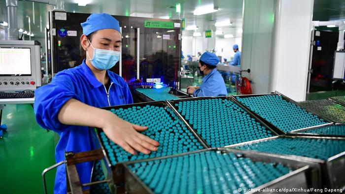 Chinese employee in a pharma factory
