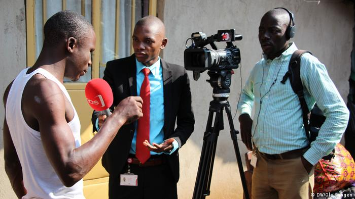 Man being interviewed by journalists