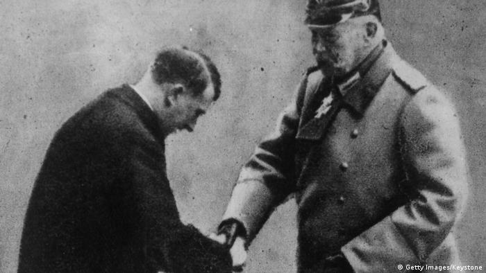 Soldier and statesman President Paul von Hindenburg handing over the rule of Germany to the Nazi leader Adolf Hitler