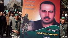 Palestinians carry a picture of Mahmoud al-Mabhouh, one of the founders of Hamas' military wing, as others carry his coffin, left, during his funeral procession at the Palestinian refugee camp of Yarmouk, near Damascus, Syria, Friday, Jan. 29, 2010. Hamas accused Israeli agents on Friday of assassinating al-Mabhouh, a veteran operative of the Palestinian militant group, saying he was electrocuted last week in a Dubai hotel room. The writing in Arabic on poster reads:Your fingerprints are everywhere ... we promise to continue in your path, and the martyr the leader Mahmoud Abed el-Raouf al-Mabhouh. (AP Photo/Bassem Tellawi)