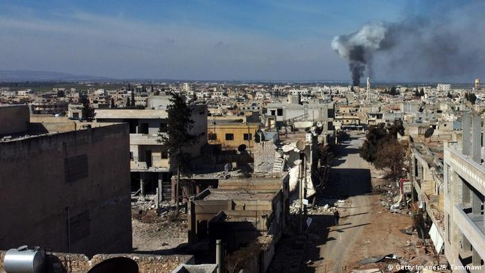 Smoke billows over the town of Saraqib in the eastern part of the Idlib province (Getty Images/A. Tammawi)