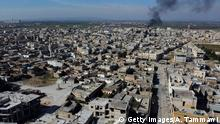 Smoke billows over the town of Saraqib in the eastern part of the Idlib province in northwestern Syria, following bombardment by Syrian government forces, on February 27, 2020. - Syrian rebels reentered the key northwestern crossroads town of Saraqib lost to government forces earlier this month but fierce fighting raged on in its outskirts today, an AFP correspondent reported. (Photo by Aref TAMMAWI / AFP) (Photo by AREF TAMMAWI/AFP via Getty Images)