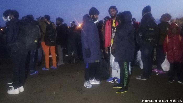 Migrants walk to the border gate of Pazarkule in Edirne