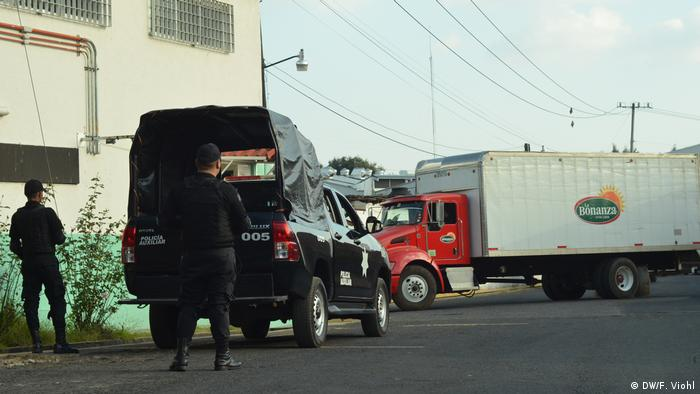 Police officers in front of avocado factory in Uruapan