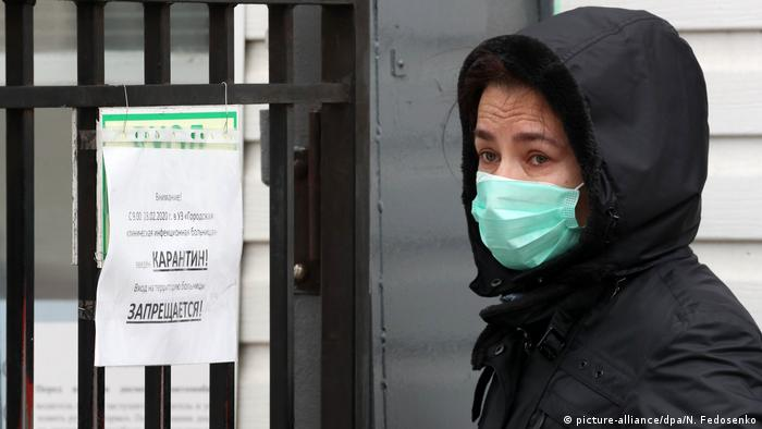 A person wears a face mask outside the Minsk Clinical Hospital of Infectious Diseases in Belarus