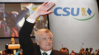 Horst Seehofer waving at a party meeting