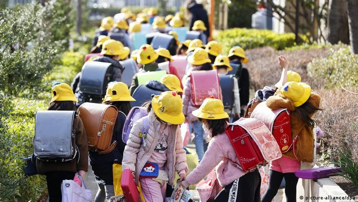 Japanese school kids leaving their school closed because of the coronavirus