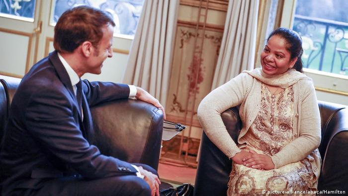 French President Emmanuel Macron meets Asia Bibi at the Elysee Palace in Paris.