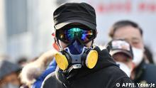 A man wears a mask and goggles as he waits in line to buy face masks from a post office near the Daegu branch of the Shincheonji Church of Jesus in Daegu on February 27, 2020. - The secretive South Korean religious group at the centre of the country's new coronavirus outbreak is a sprawling network so wealthy it can mobilise thousands of believers to hold Pyongyang-style mass performances at Seoul's Olympic stadium. More than half of the country's nearly 1,600 infections are linked to Shincheonji followers. (Photo by Jung Yeon-je / AFP)