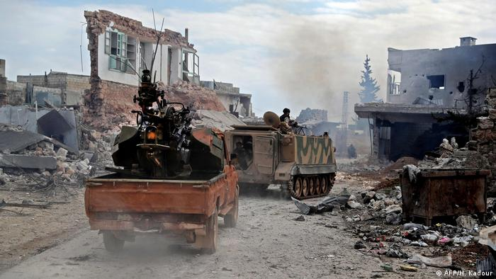 Turkish and rebel troops in Idlib (AFP/H. Kadour)
