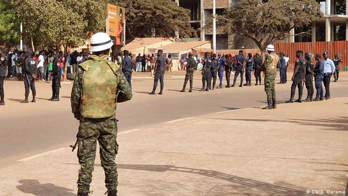 Several military personell standing with guns
