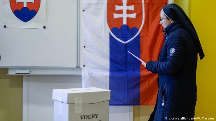 A nun casts her ballot during the Slovakian parliamentary elections in Trnava, Slovakia