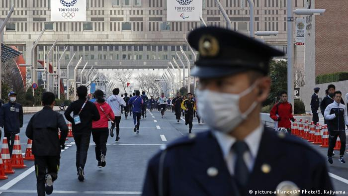 Police officer wears a facemask at the Tokyo Marathon