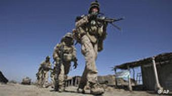 US Marines with NATO forces patrol in a deserted market of Marjah, Afghanistan