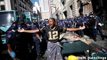 A woman wails as law enforcement officials move in to disperse a group of immigrants who had occupied a historic church and a square demanding to be moved to another country as they claimed to feel not safe because of xenophobic attacks, in central Cape Town South Africa, March 1, 2020. REUTERS/Mike Hutchings
