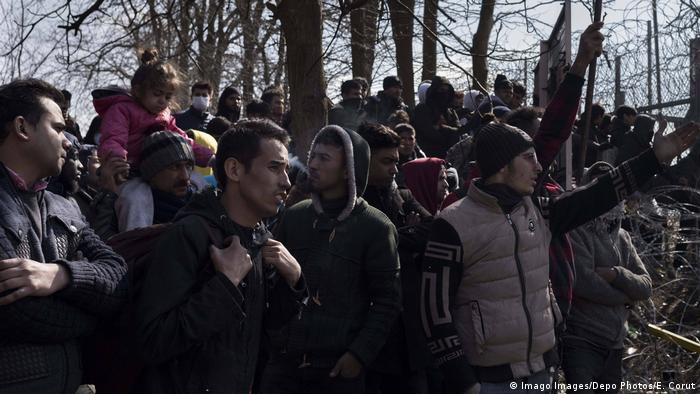 Refugees wait in front of the Greek border at Pazarkule gate, in Edirne, Turkey.