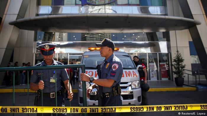 Two Philippines police officers
