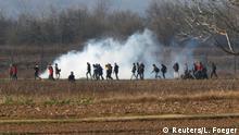 Migrants are seen amid tear gas near Turkey's Pazarkule border crossing with Greece's Kastanies, near Edirne, Turkey, March 2, 2020. REUTERS/Leonhard Foeger