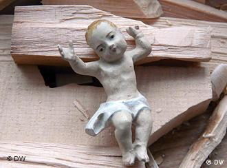 Detail of a wood carving of Baby Jesus