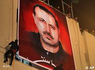 A poster showing Mahmoud al-Mabhouh on display at a rally