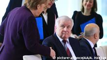 BERLIN, GERMANY - MARCH 02: German Interior Minister Horst Seehofer refuses shaking hand with the German Chancellor Angela Merkel during Integration Summit at Prime Ministry building in Berlin, Germany on March 02, 2020. German Interior Minister Horst Seehofer didn't shake hands with the Chancellor Merkel due to the spread of Coronavirus (Covid-19) as Merkel sat next to him at the meeting. Abdulhamid Hosbas / Anadolu Agency   Keine Weitergabe an Wiederverkäufer.