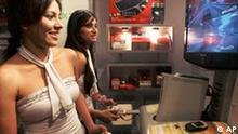 Visitors play a video game at the India Gaming Summit 2007, in Mumbai, India, Wednesday, Nov. 28, 2007. Sony Online Entertainment LLC plans to set up a development studio in India for online games that would have local content and a local partner, a company official said Wednesday. (AP Photo/Rajesh Nirgude)