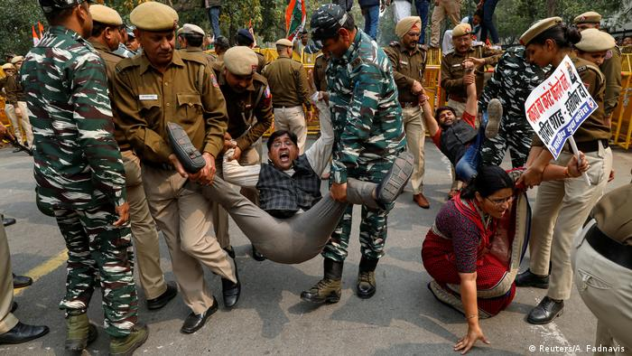 Police detains activists of the youth wing of India's main opposition Congress party during a protest