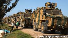 02.03.2020*****A Turkish military convoy is seen parked near the town of Batabu on the highway linking Idlib to the Syrian Bab al-Hawa border crossing with Turkey, on March 2, 2020. - The Syrian government pledged to repel Turkish forces attacking its Russia-backed troops in northwestern Syria as tensions spike between Damascus and Ankara. Since December, Syrian regime forces have led a deadly military offensive against the last major opposition stronghold of Idlib, where Turkey supports some rebel groups. Damascus said it shot down three Turkish drones in the region the day before, while two Syrian warplanes were downed though the pilots escaped unharmed. (Photo by AAREF WATAD / AFP) (Photo by AAREF WATAD/AFP via Getty Images)