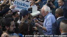 Democratic presidential candidate Sen. Bernie Sanders, I-Vt., signs autographs to Latino supporters at a campaign event at Valley High School in Santa Ana, Calif., Friday, Feb. 21, 2020. (AP Photo/Damian Dovarganes)  