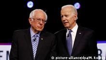 ARCHIV - 25.02.2020, USA, Charleston: Die demokratischen Bewerber um die Präsidentschaftskandidatur, Bernie Sanders (l) und Joe Biden, stehen während einer TV-Debatte nebeneinander. In zahlreichen US-Bundesstaaten haben Wähler am sogenannten «Super Tuesday» darüber abgestimmt, wer im November als Kandidat der Demokraten gegen Präsident Trump antreten soll. Foto: Matt Rourke/AP/dpa +++ dpa-Bildfunk +++