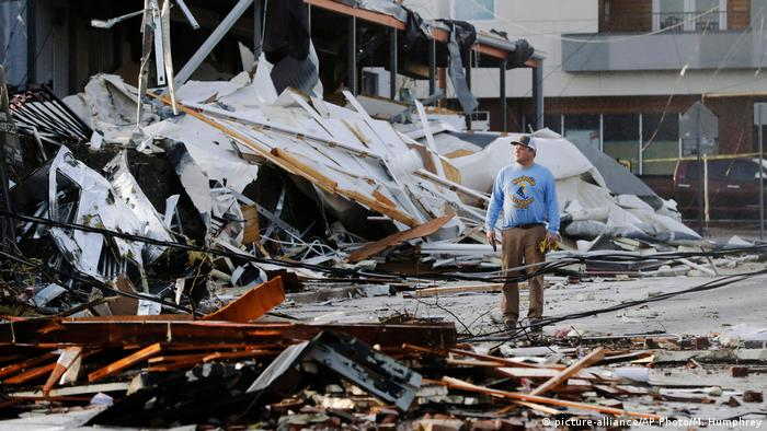 A man looks at buildings destroyed by storms in Tennessee, US.