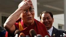 The Dalai Lama talks to reporters outside the West Wing of the White House in Washington, Thursday, Feb. 18, 2010, after meeting with President Barack Obama. (AP Photo/Gerald Herbert)