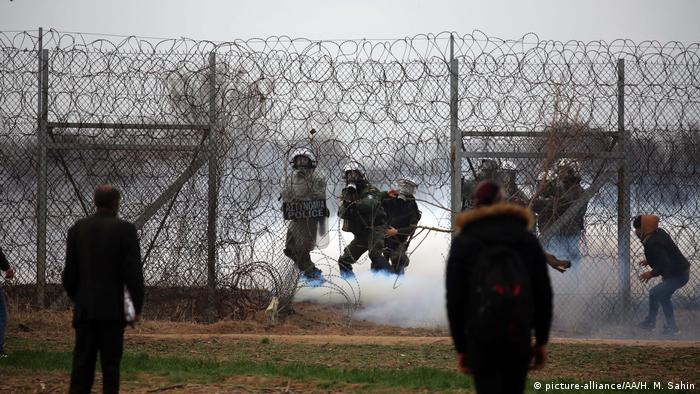 Greek security forces intervene with tear gas as migrants continue to wait at the Turkey-Greece border