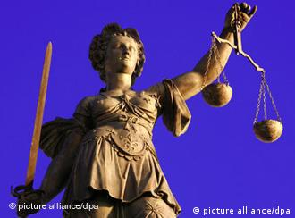 A statue of the Roman goddess of justice, holding a scale