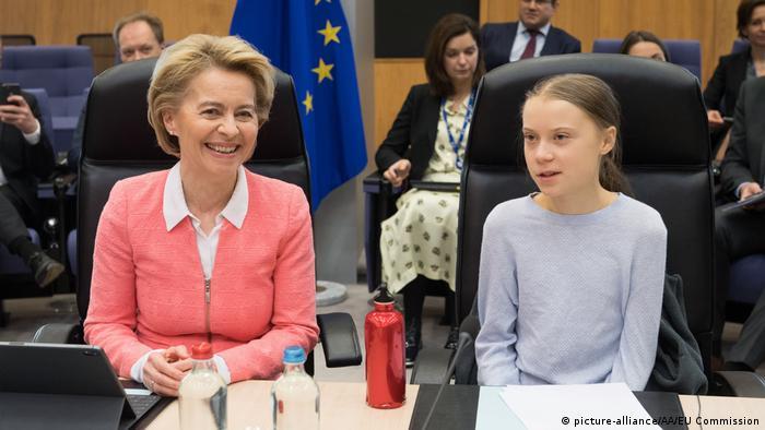 Ursula von der Leyen and Greta Thunberg sit together